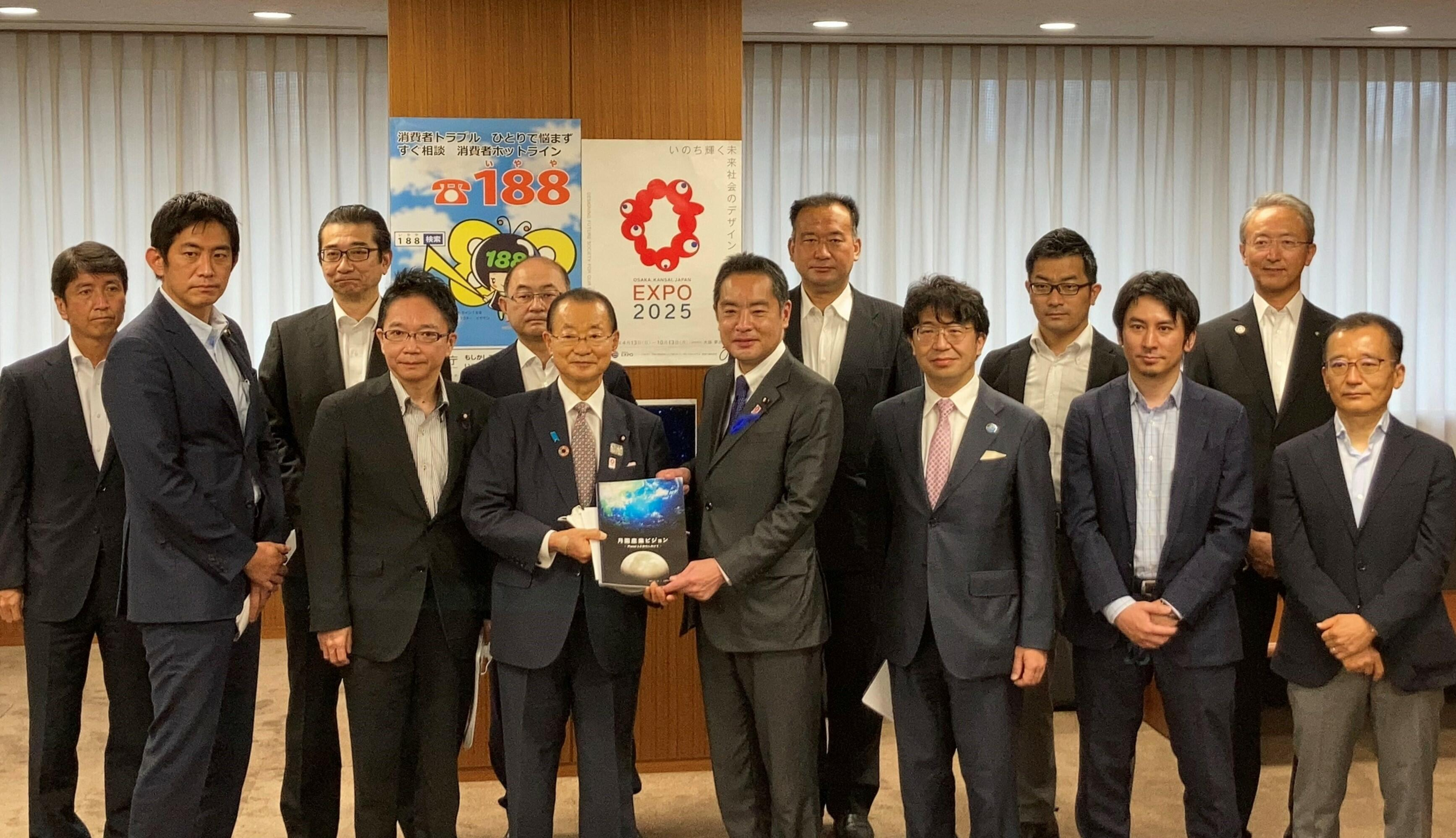 Takeo Kawamura, a member of the House of Representatives (sixth from the left), handing the Lunar Industry Vision to Minister of State for Science and Technology Policy Shinji Inoue, (seventh from the left), accompanied by Lunar Industry Vision Council representatives and Senior Executive Officer Takuya Hanada of JGC Corporation (third from the left)